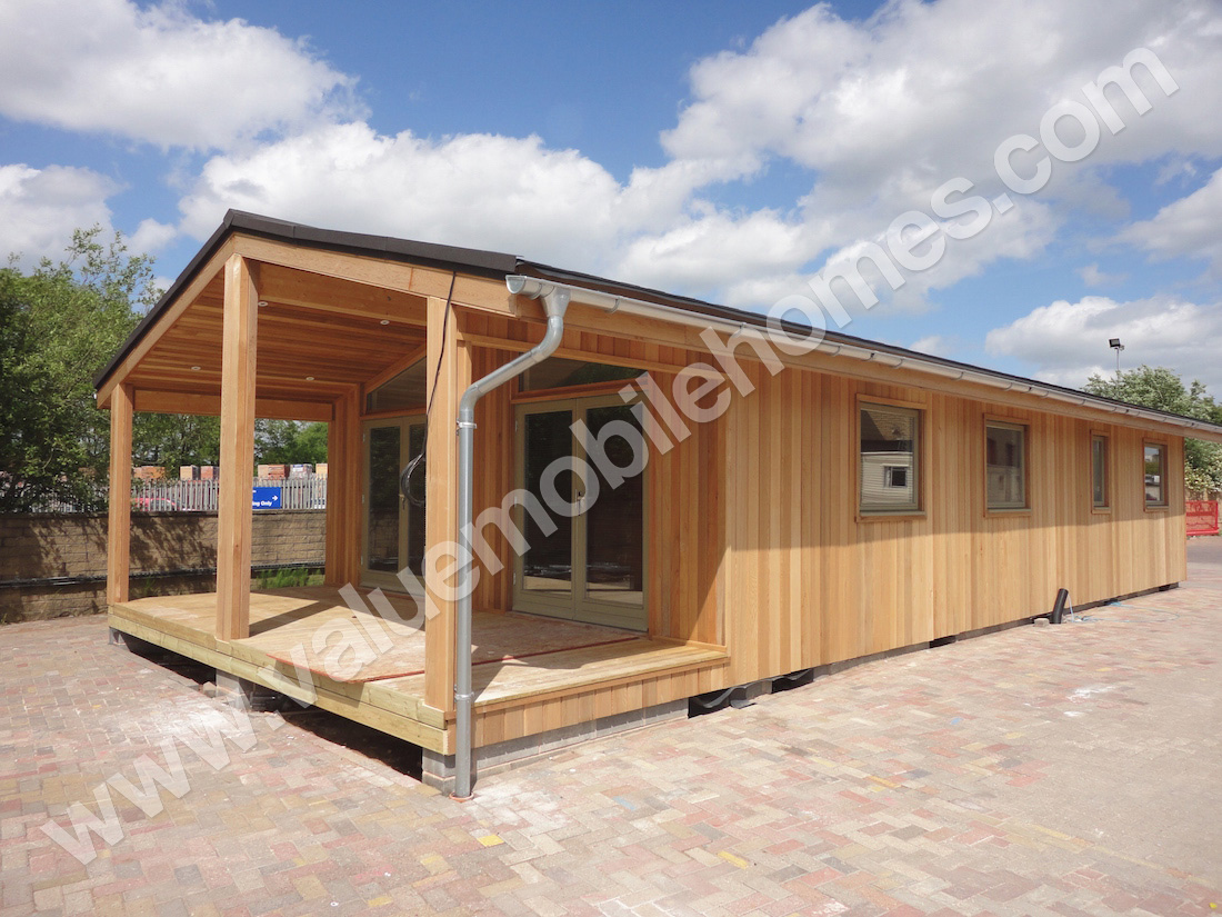 Image gallery log look mobile homes for Log cabin builders in alabama
