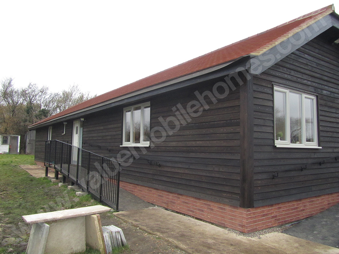 Mobile home normandy barn style twin unit log cabin for Barn style modular homes